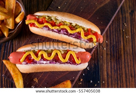 Hot Dog With Yellow Mustard, Onion, Pickles and French Fries
