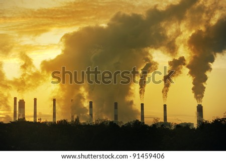 Hot water from a large chimney From the factory Black smoke is released every day. The environment is full of pollution and small dust