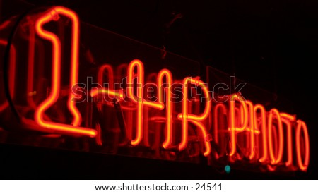 1 hour photo neon sign taken with a short time laps (bulb exposure) for effect - stock photo