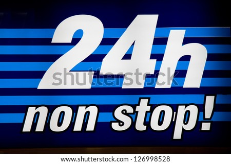 24 Hours neon sign - stock photo