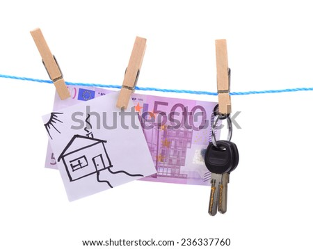 house future dreams come true successful in earning the family a house painted in a child's hand and five hundred euros hanging on a lanyard attached clothespins - stock photo
