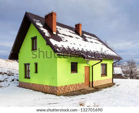 House in winter scenery - stock photo