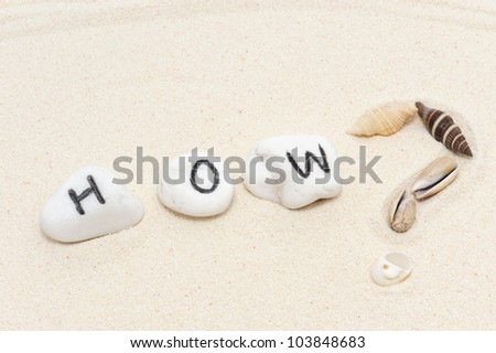 """How?"" word on group of stones decorated with sea shells"