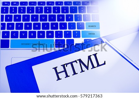 HTML word in business concepts, technology background in laptop and notepad