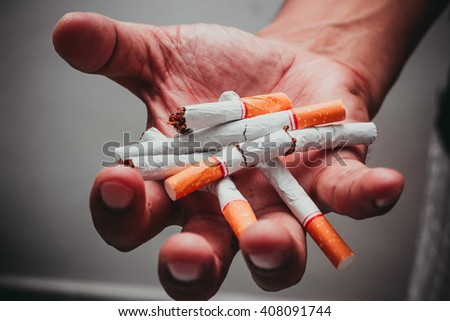 Human hands breaking the cigarette, Concept Quitting smoking,World No Tobacco Day - stock photo