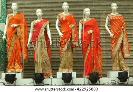 HYDERABAD,INDIA-MAY 19:Mannequins dressed in latest Indian saris in front of a retail cloth shop on May 19,2016 in Hyderabad,India.