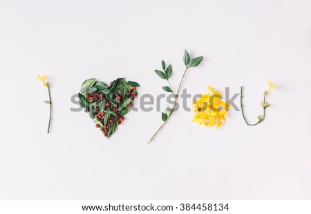 """I heart you"" made of flowers, leaves, berries and coffe beans. - stock photo"