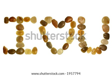 """I love you� message written in polished pebbles from the beach and isolated on a white background."