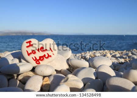 �¢??I Love you�¢?� written on heart shaped stone on the beach - stock photo
