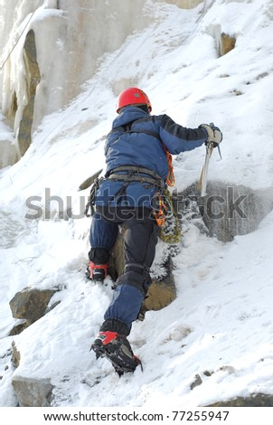 ice climbing an attractive route. - stock photo