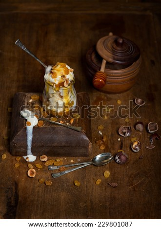 Ice cream for ancient style cooking with vintage utensils on an old wood table in an antique kitchen of a historic home