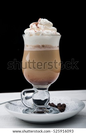 iced coffee frappe in glass on wood table