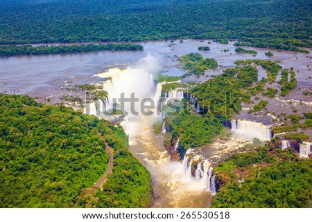 Iguazu River spreads widely among the dense tropical forests. Devil's Throat - largest waterfall of the Iguazu Falls. Picture taken from a helicopter - stock photo