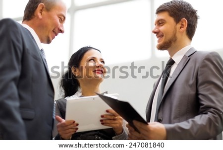 image of a business team discussing the latest financial results - stock photo