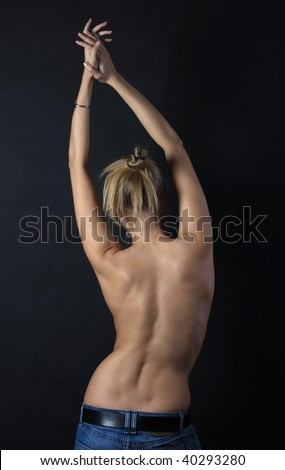 image of a female back on a black background