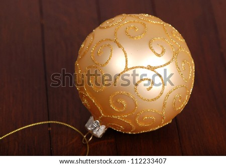 image of decorative golden ball over wooden background