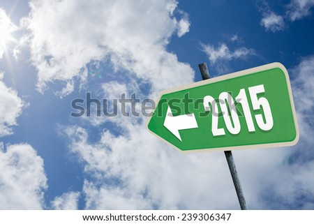 2015 in bold grey against bright blue sky with clouds