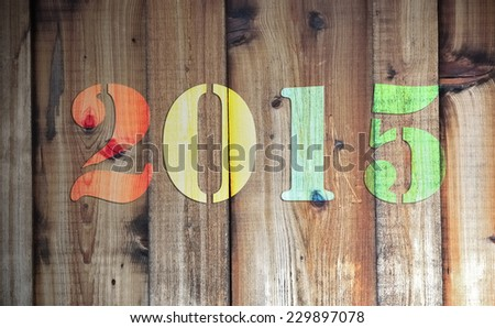 2015 in different colors on wooden background - stock photo