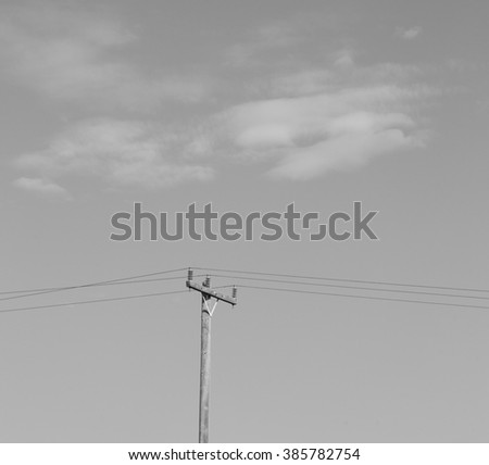 in the cloudy  sky and abstract background current pole     electricity line