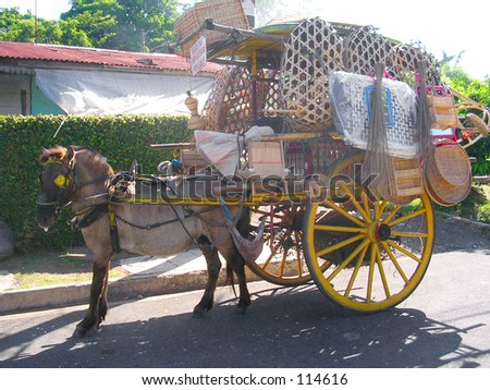 (In the Philippines) Household items sold 'round the street in a horse carriage.