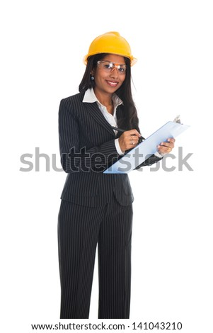 Indian female architect engineer holding plans and smiling - stock photo