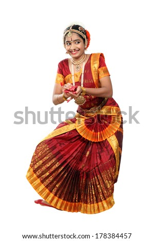 Indian female performing Bharathanatyam in action of   Lord Vishnu's avtar -Kurma a turtle
