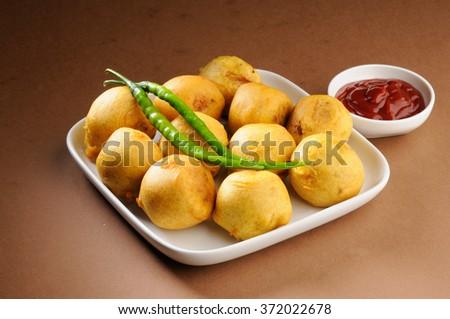 indian home made snack called batata vada or aalu bonda   - stock photo