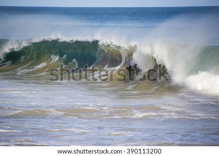 Indian Ocean waves splashing  onto the shore  at Ocean Beach, Bunbury, Western Australia on a cold day in early winter are dramatically majestic. - stock photo