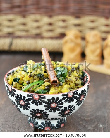 indian rice -khichdi in to the bowl - stock photo