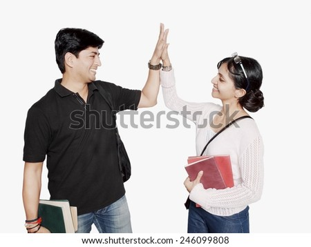 Indian student greeting each other over isolated white background.                                                               - stock photo