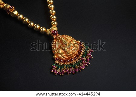 Indian Traditional Gold Necklace with Lakshmi Pendant  - stock photo