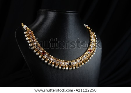 Indian Traditional Gold Necklace with Pearls  - stock photo
