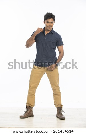 Indian young boys dancing in casual dress on white background. - stock photo