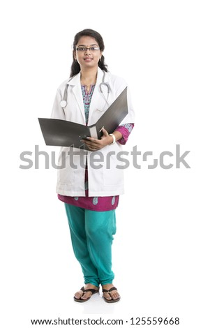 Indian young female doctor with document on white.
