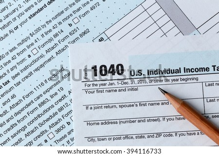 1040 Individual Income Tax Return Form for 2015 year with a pencil to fill in, close up