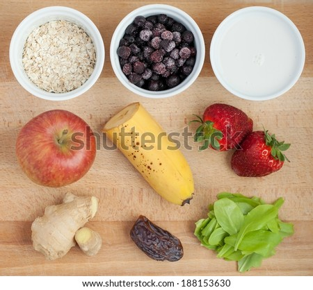 Ingredients for smoothie on wooden desk - stock photo