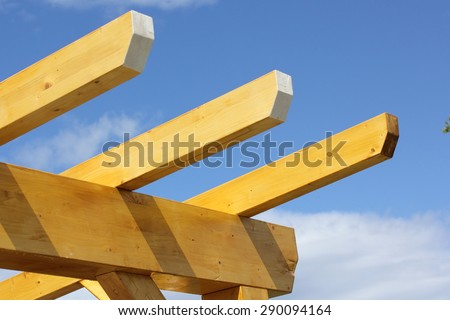 Installation of wooden beams at construction  - stock photo