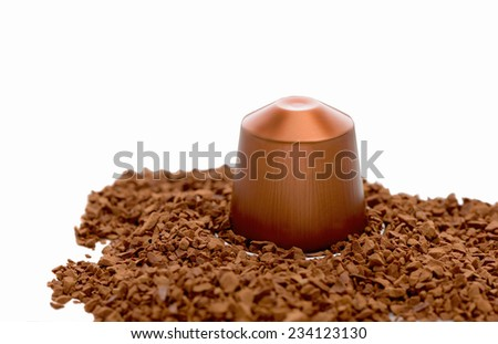 instant coffee granules and capsule, isolated over white background - stock photo