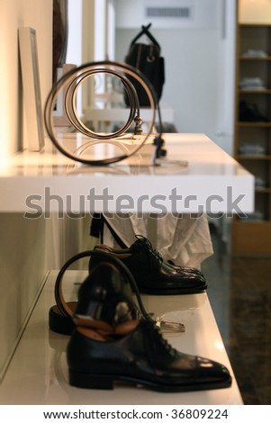 Interior of a mens wear store, business clothing - stock photo