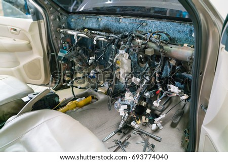 interior view of a car repair & electric wiring system showing wires in a car,