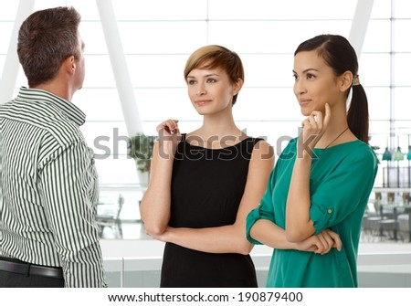 . Interracial businesspeople talking in business hall - stock photo