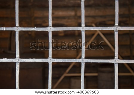 Iron bars in a prison cell.
