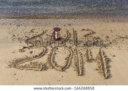 2014 is coming to the sandy beach of Eilat - famous Israeli resort city located on the Red Sea - stock photo