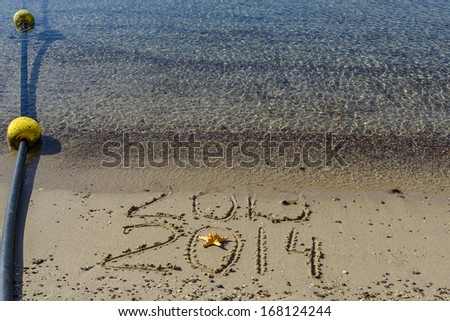2014 is coming to the sandy beach of Eilat - famous resort city in Israel - stock photo