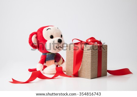 2016 is year of the monkey decorate with gift box and red ribbon for chinese new year