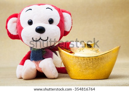 2016 is year of the monkey decorate with gold ingot for chinese new year - stock photo