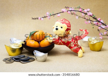 2016 is year of the monkey decorate with mandarin orange,  gold, silver ingot, ancient money and plum blossom for chinese new year - stock photo