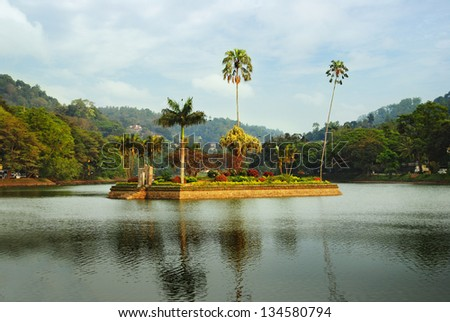 island housing the Royal Summer House is in the middle of the Kandy lake, Sri Lanka - stock photo