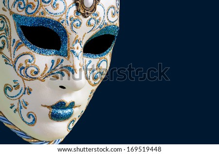 Isolated Blue Venetian mask on a blue  background - stock photo