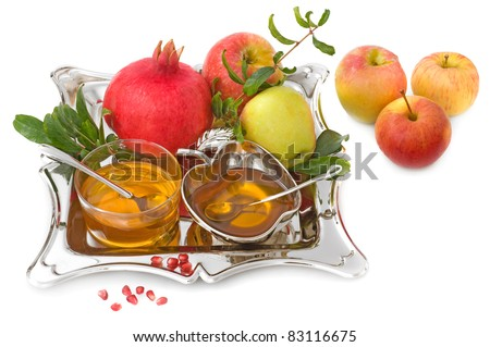 isolated ripe apple  ,pomegranates with leaves and honey for Rosh Hashana– jewish new year - stock photo